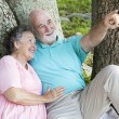 Stock Photo: Seniors Bird-Watching in Park