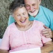 Seniors Connect with Netbook - Stock Photo