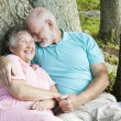 Seniors Flirting Like Teenagers - Stock Photo