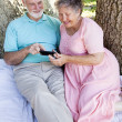 Senior Couple with Smart Phone — Stock Photo
