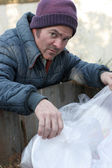 Homeless Man - Digging In Dumpster — Stock Photo