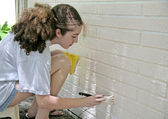 Teen Painting House Trim — Stock Photo