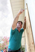 Hurricane Preparation - Attaching Plywood — Stock Photo