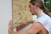 Screwing Plywood on Window — Stock Photo