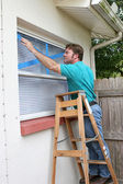 Taping Window Glass — Stock Photo