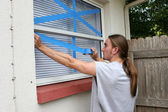 Teen Taping Windows H — Stock Photo