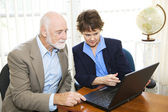 Broker and Client View Assets Online — Stock Photo