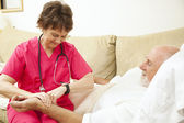 Home Health Nurse Takes Pulse — Stock Photo