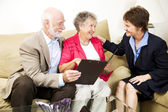 Senior Couple and Saleswoman — Stockfoto