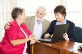 Senior Couple with Financial Advisor — Stock Photo