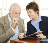 Senior Reluctant to Sign Contract — Stock Photo