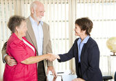 Seniors Meeting Financial Advisor — Stock Photo