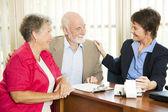 Seniors with Accountant — Stock Photo