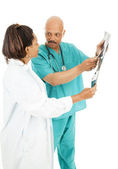 Doctors Discuss X-Ray Results — Stock Photo