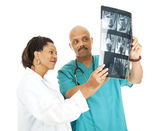 Medical Team Reviews X-Rays — Stock Photo