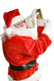 Santa Stuffing Stockings — Stock Photo