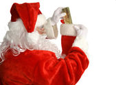 Santa Stuffs Stocking — Stock Photo