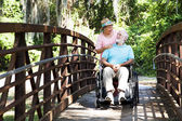 Senior Caretaker on Bridge — Stock Photo