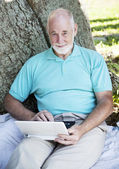 Senior Man with Netbook — Stock Photo