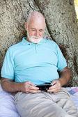 Senior Man with Smart Phone — Stock Photo