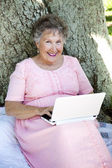 Senior Woman With Netbook — Stock Photo