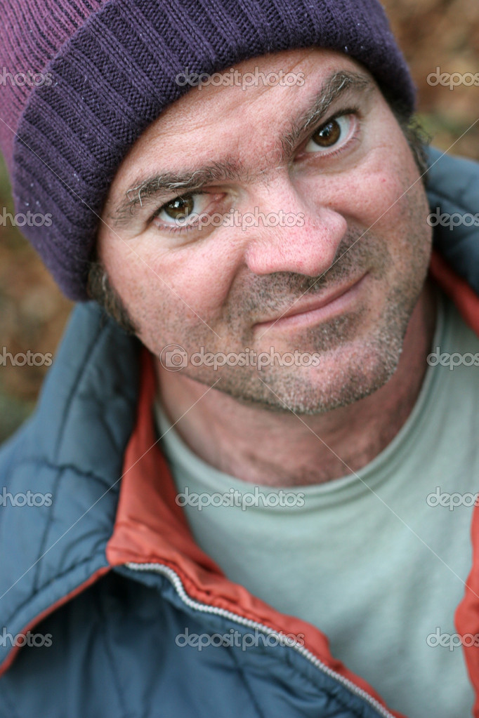 A closup portrait of a homeless man.  Shallow depth of field, with focus on his left eye.  Stock Photo #6812875