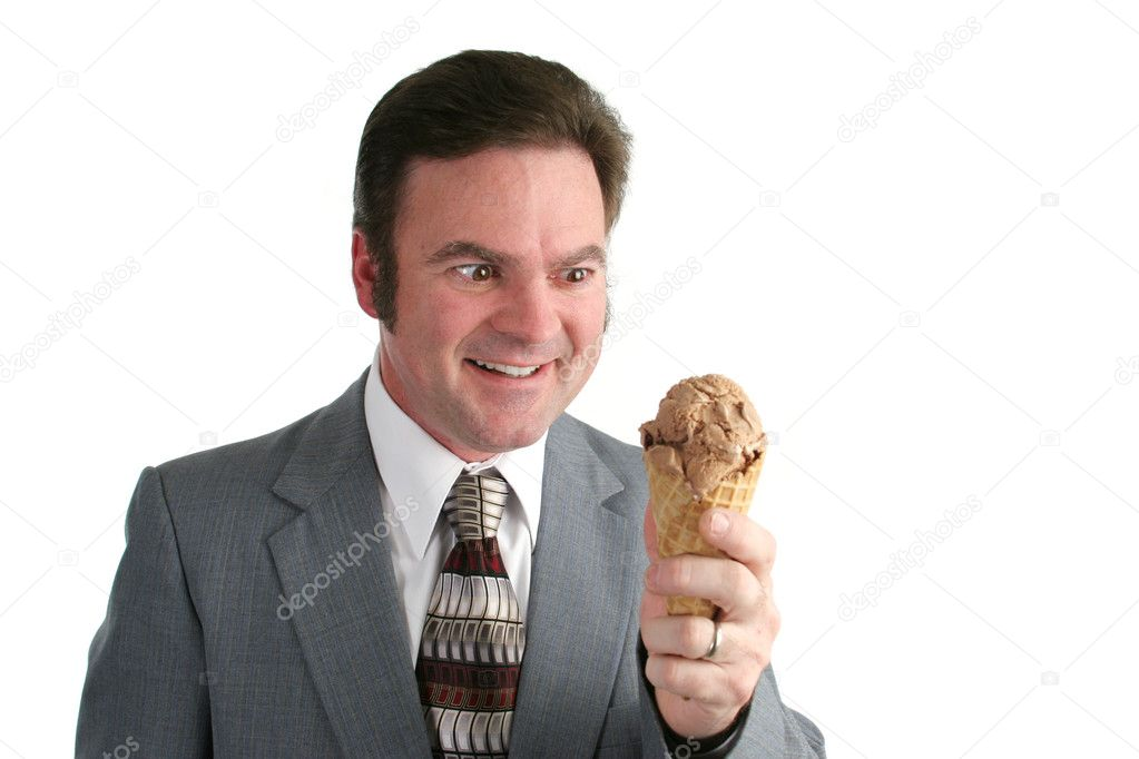A businessman looking at an ice cream cone with a crazed look. — Foto Stock #6813787