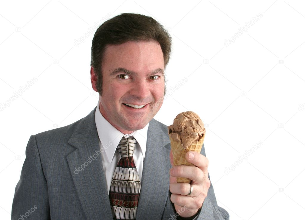 A businessman holding an ice cream cone and smiling a big grin. Isolated. — Stock Photo #6813789
