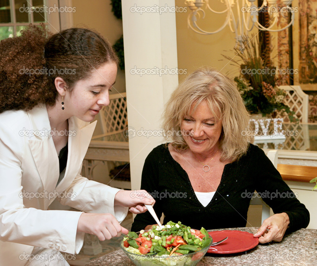A teen girl and a mature woman eating a healthy salad for lunch. — Stock Photo #6813957