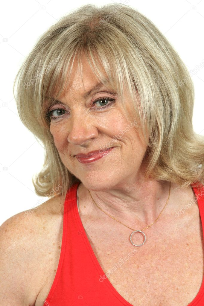 Portrait of a beautiful mature blond woman in red. — Stock Photo #6813966