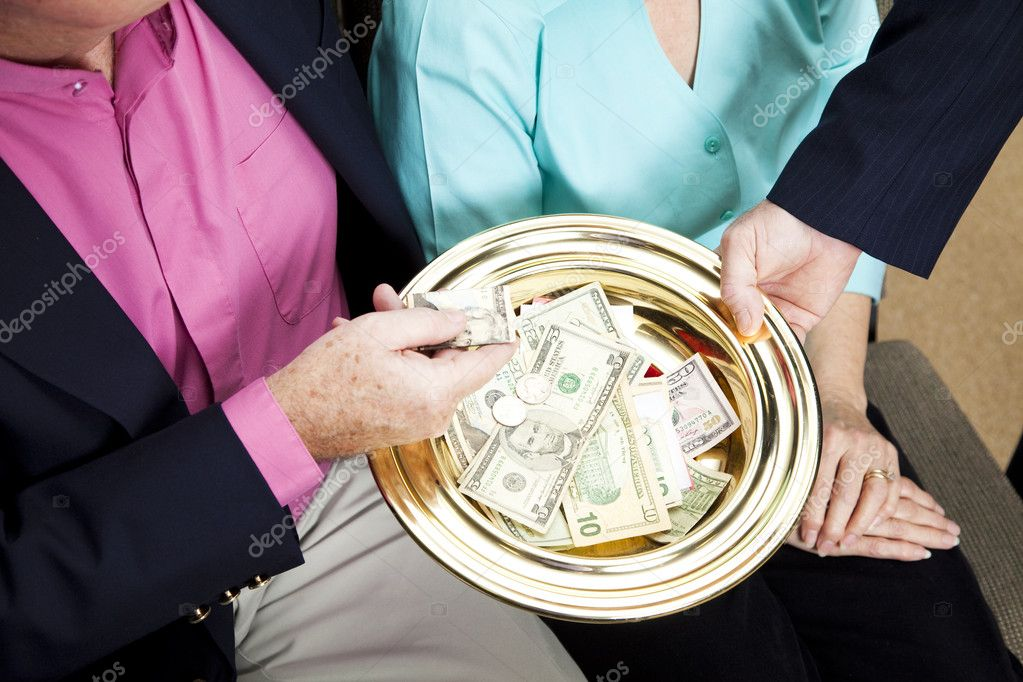 Church receives donations by passing the collection plate.    Stock Photo #6815502