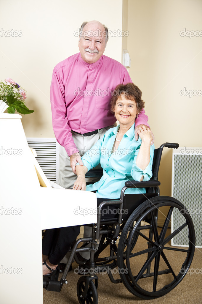 Disabled piano player and her loving, supportive husband.   — Stock Photo #6815530