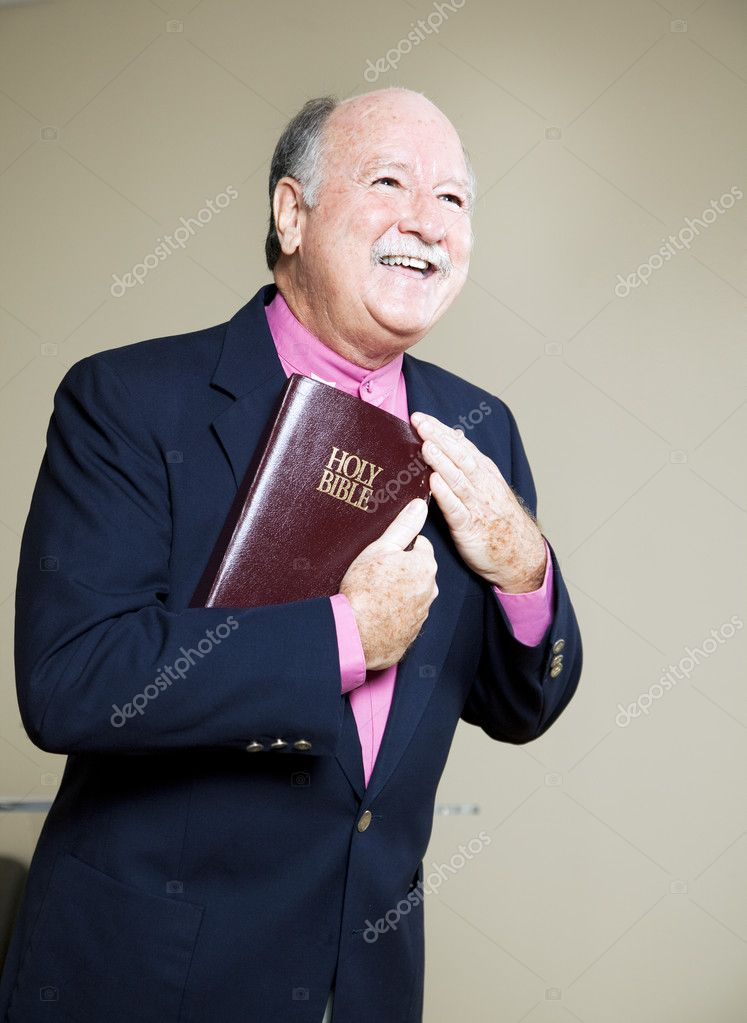 Happy minister holding the Bible and preaching a message of love.   — Stock Photo #6815579