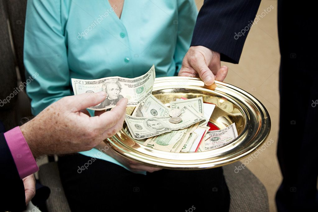 Church members putting money in the collection plate.    Stock Photo #6815627