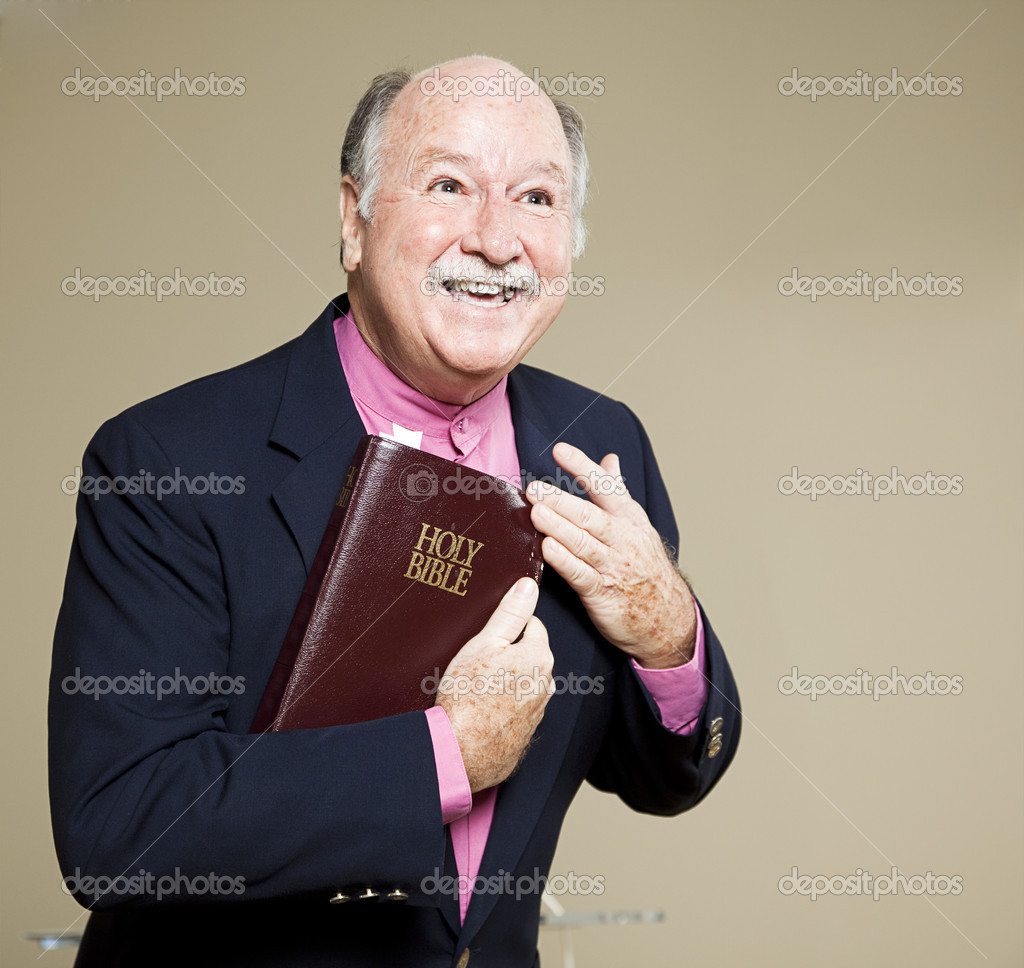 Friendly minister in church giving his sermon on the bible.   — Stock Photo #6815639
