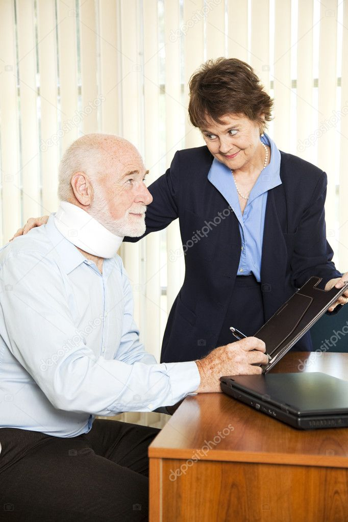 Injured senior man signs paperwork at his attorney's office.   — Stock Photo #6815887