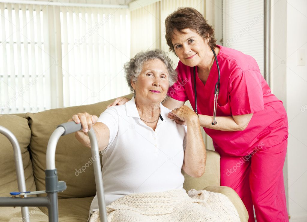 Friendly nurse cares for an elderly woman in a nursing home.    Stock Photo #6815921