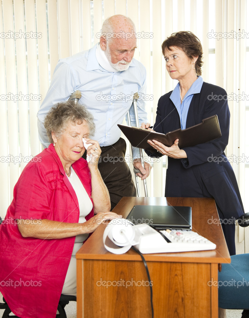 Injured senior man and his upset wife meet with a personal injury lawyer.   — Stock Photo #6815938