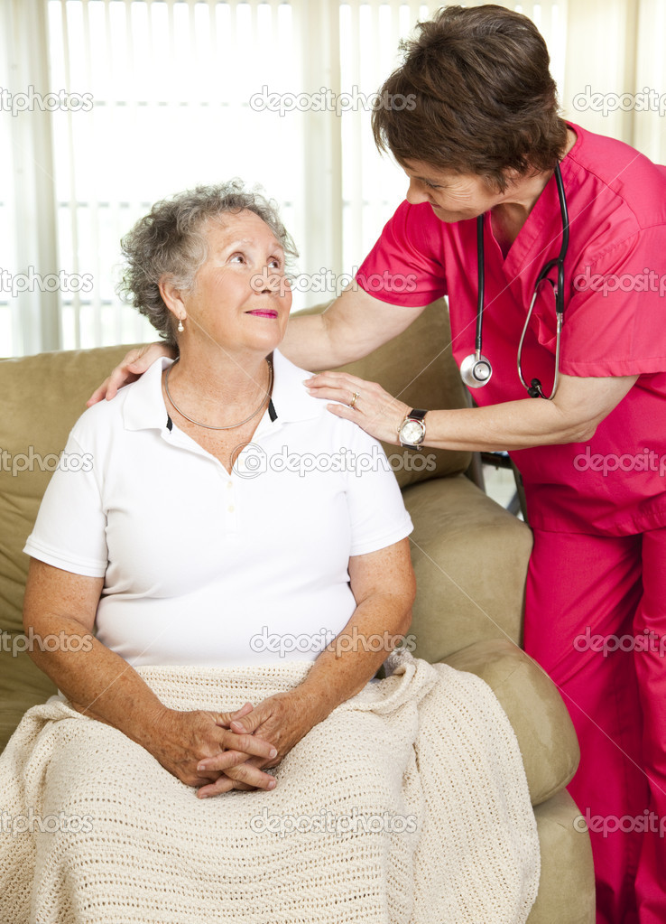 Nurse helps senior woman.  Could either be in-home care or at a nursing home or assisted living facility.    Stock Photo #6815964