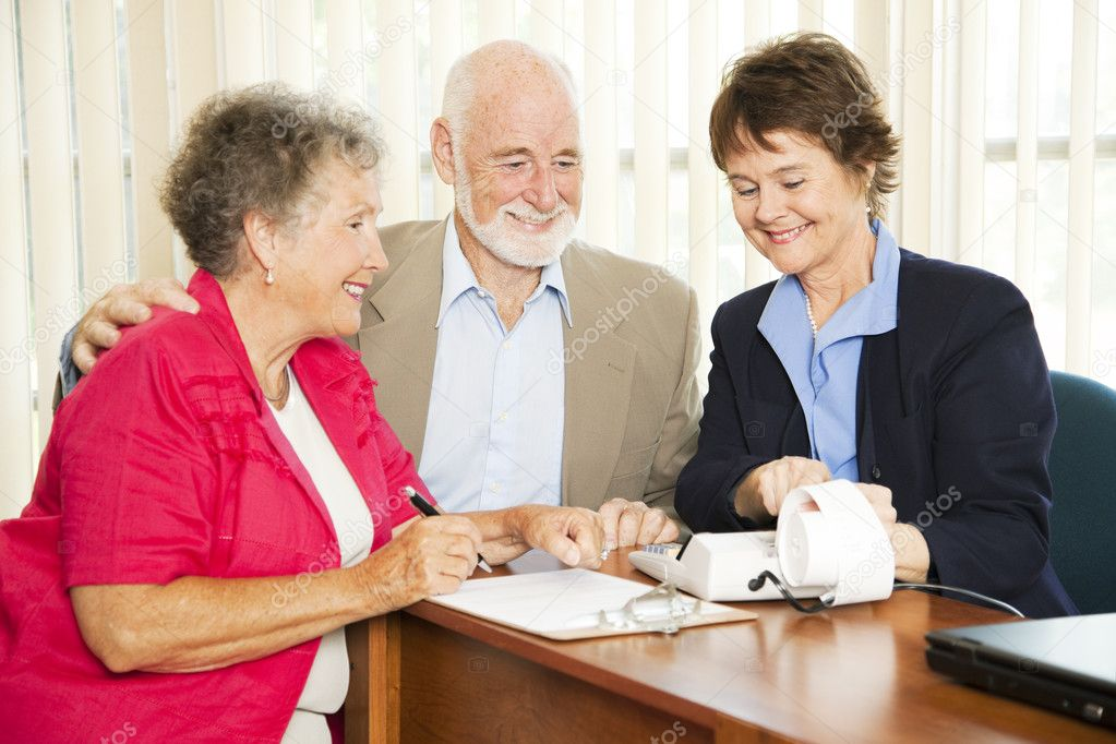 Senior couple gets good financial news from their accountant. — Stock Photo #6815967