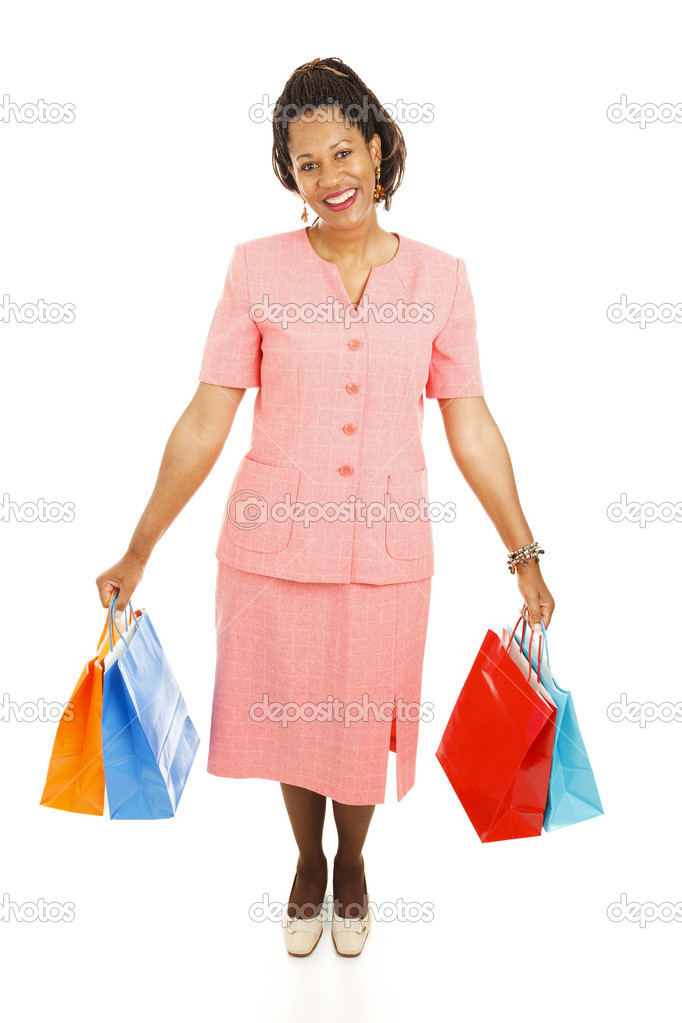 Happy african-american woman with her shopping bags.  Full body isolated on white   — Stock Photo #6816283