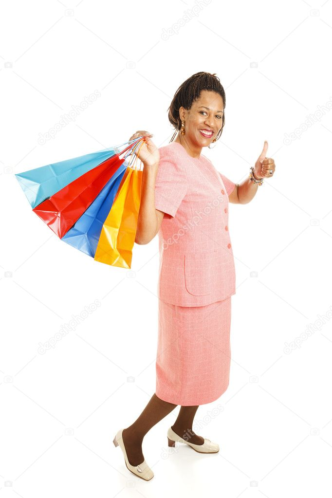 Beautiful African-american woman with shopping bags, giving the thumbs-up sign.  Full body isolated on white. — Stock Photo #6816286