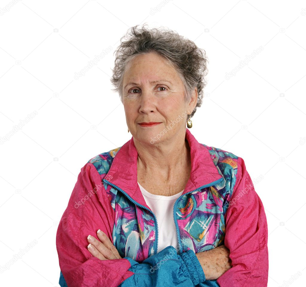 A senior woman in a track suit with her arms crossed and a distrustful expression.  Isolated on white.  Stock Photo #6816684