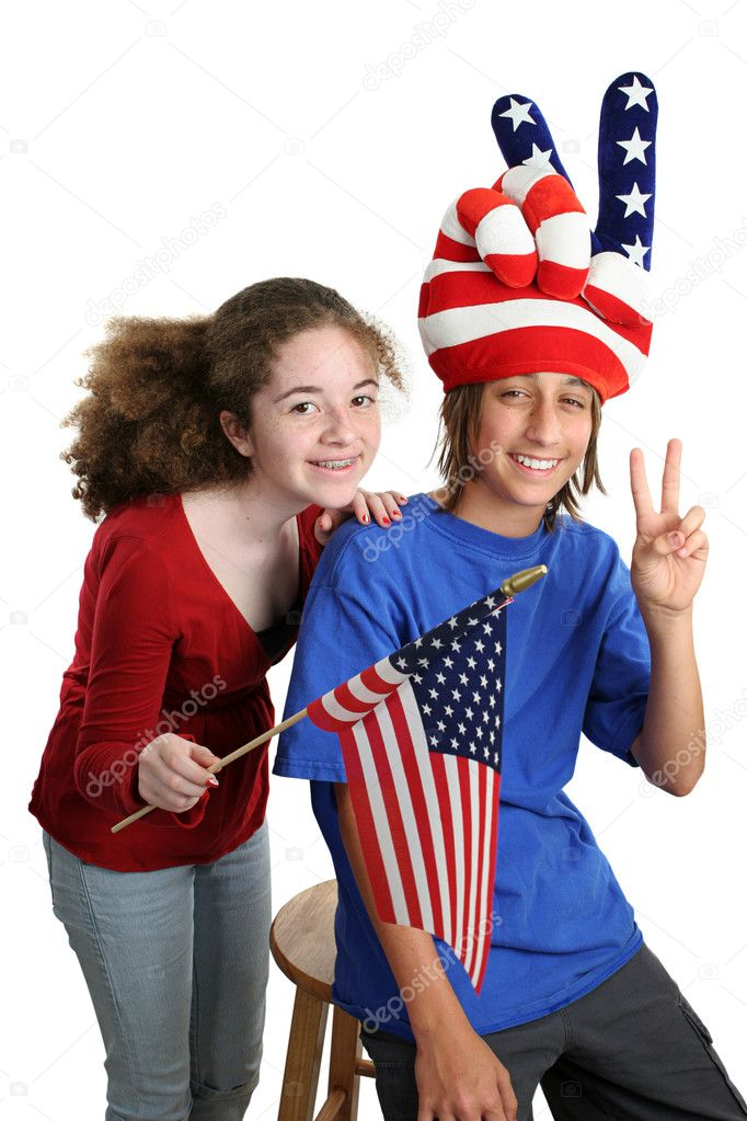 Two teens celebrating American Independence Day with patriotic hat and US flag.  Isolated. — Stock Photo #6816922