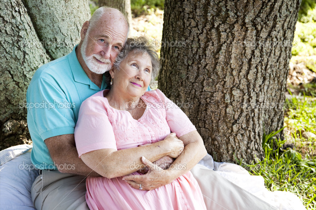 Nostalgic senior couple sitting outdoors and remembering.    Stock Photo #6817031