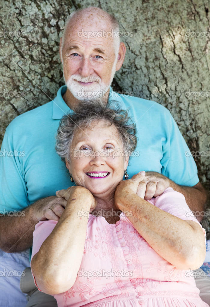 Senior couple relaxing outdoors.  Focus on the wife.    Stock Photo #6817056
