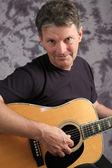 Stock Photo of Mature Male Guitarist 5 — Stock Photo