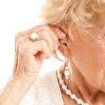 Inserting Hearing Aid — Stock Photo
