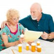 Senior Couple - Medical Bills — Stock Photo #7292106