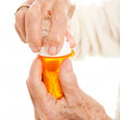 Senior Hands on Prescription Bottle — Stock Photo